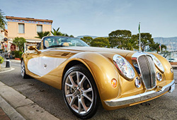 golden luxury car hire in a coastal town on the French Riviera